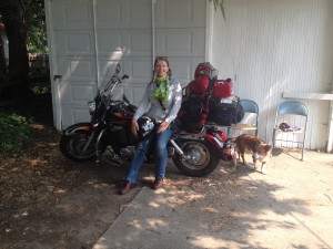 Woman, dog, motorcycle.